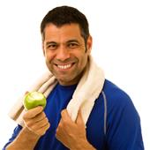 A happy mid-adult man eating an apple after working out.